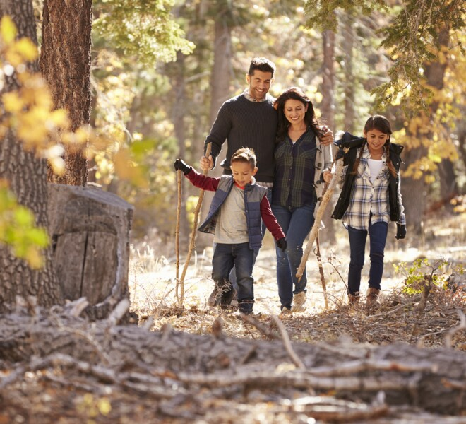 Family in fall forest