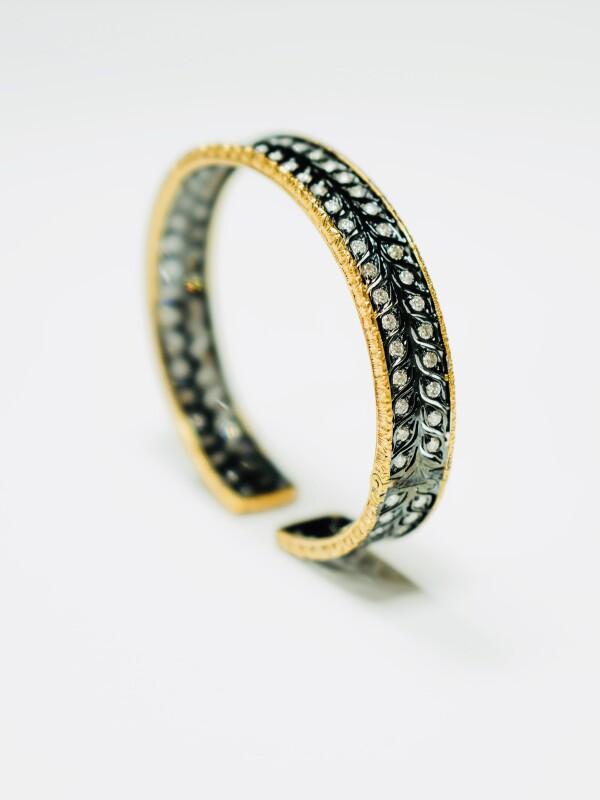 Black, gold, and diamond bracelet