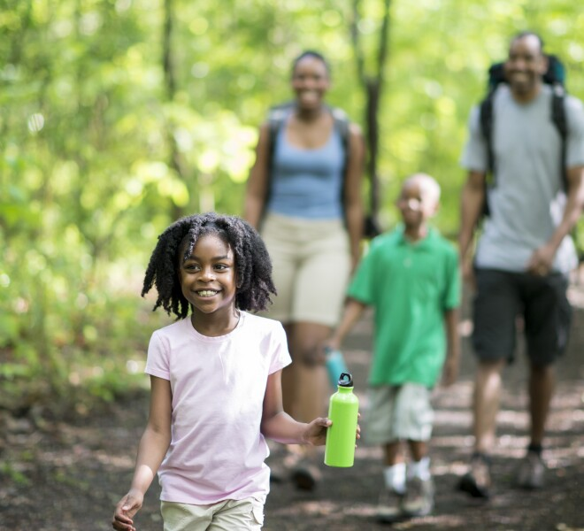 Family enjoying the forest in summer