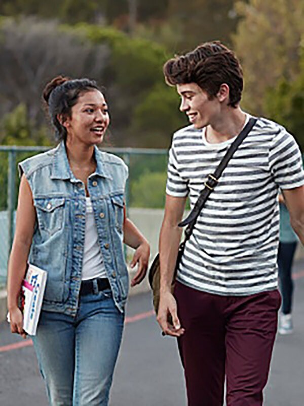 Two young college students walk together while deep in discussion.