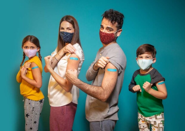 Family Wearing Masks with Bandaids on Arms