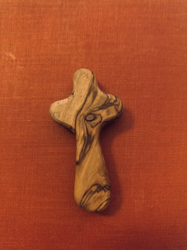 Wooden Cross With A Red Background
